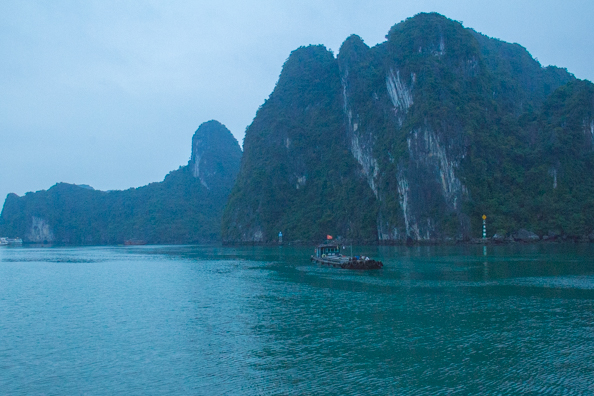 Working boat in Ha Long Bay, Vietnam