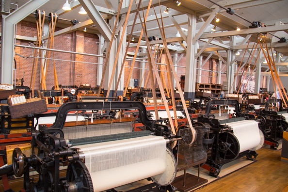 Working weaving machines in the Textile Machinery Pavilion of the Toyota Museum in Nagoya, Japan