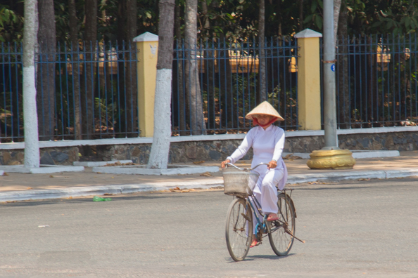 Worshipper arriving at the Cao Dai Temple at Tay Ninh in Vietnam