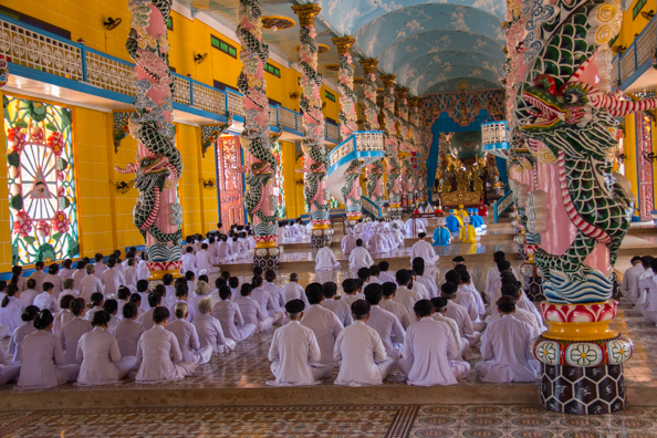 Worshipping in the Cao Dai Temple at Tay Ninh in Vietnam
